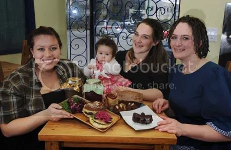 Jazmin Riddell, Tessa Pauls (3 months), Barbara Schellenberg (Tessas mom) and sister Fiona Schellenberg of the Ethical Kitchen in North Vancouver. On the table is a beef burger, beef stock, borscht, pastries and a Jitterbug (a chocolate cake made with esspresso).