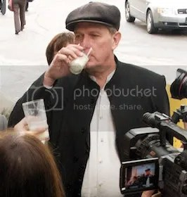 Raw milk farmer Michael Schmidt raises a glass of the good stuff in a toast to supporters outside a Newmarket courthouse where he was tried in October 2008