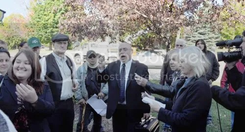 Defence lawyer Peter Rosenthal with speaks with reporters and some of the Site 41 protesters outside Midland court building. Photo contributed by J.E. (Jim) Simpson. Photo via Barrie Examiner website
