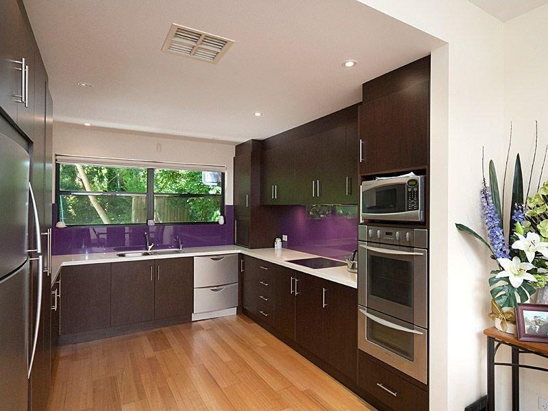 Modern U-shaped Kitchen Design Using Floorboards