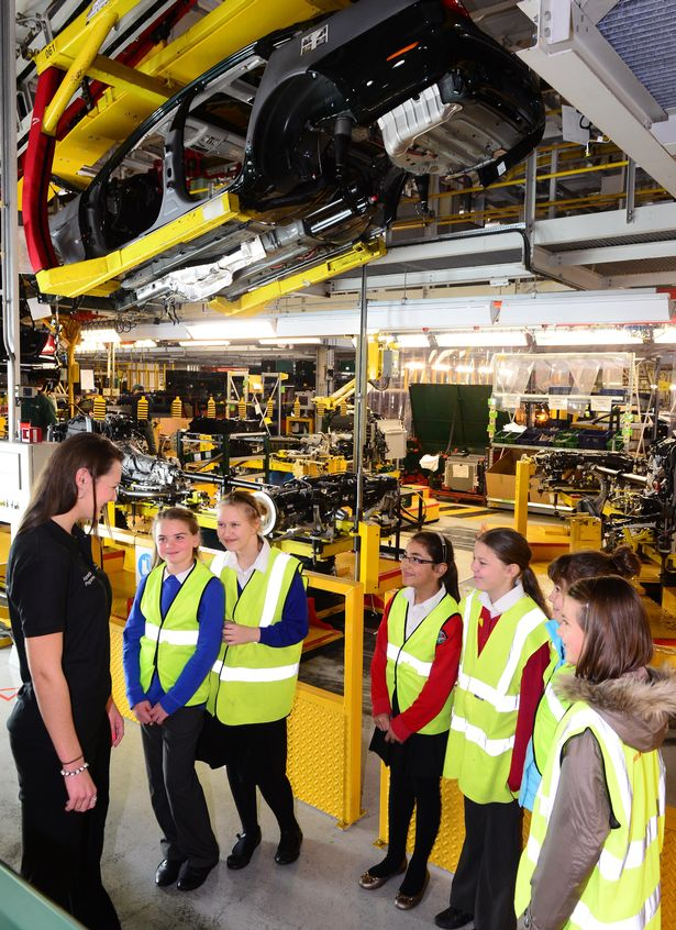 Advanced apprentices Lauren Leigh explains how cars are built to young visitors.
