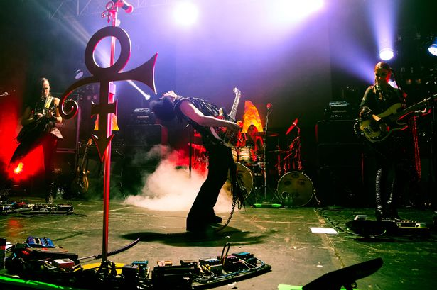 Funk n' Roll - Prince jamming on stage with 3RDEYEGIRL. Photo taken from Manchester Evening News