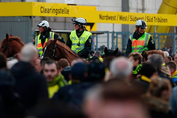 Police patrol on horseback outide the stadium