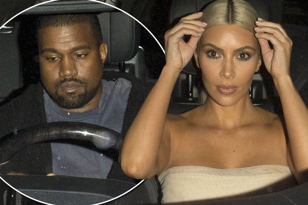 Image result for Kanye and Kim's Security Draws Guns On Burglar Who Ransacked Their Cars