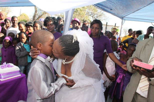 Groom Sanele Masilela (9) gets a kiss from his bride Helen Shabangu (63) at their second ritual marriage ceremony in Kildare Village, Ximhungwe near Bushbuckridge in Mpumalanga, South Africa.