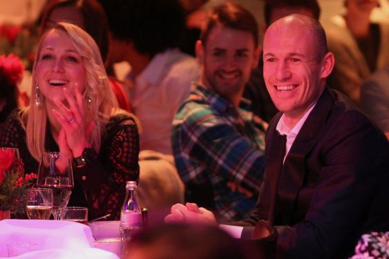 Arjen Robben and his wife Bernadien Robben attend the FC Bayern Muenchen christmas party at Schuhbeck's Teatro restaurant on December 7, 2014 in Munich, Germany.