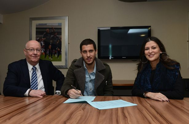 Chelsea's Eden Hazard signs a new contract in the presence of club secretary David Barnard and Director Marina Granovskaia