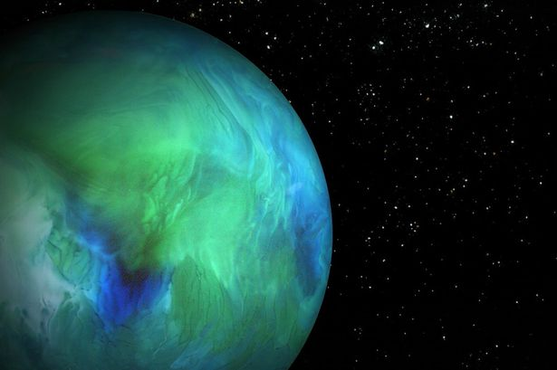 Planet - bottom of a glass containing half and half, water, food coloring
