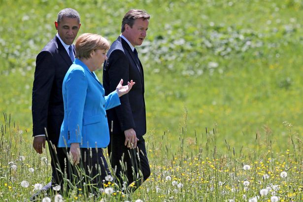 U.S. President Barack Obama, German Chancellor Angela Merkel and British Prime Minister David Cameron walk to attend their first meeting in the hotel castle Elmau in Kruen, Germany, June 7, 2015