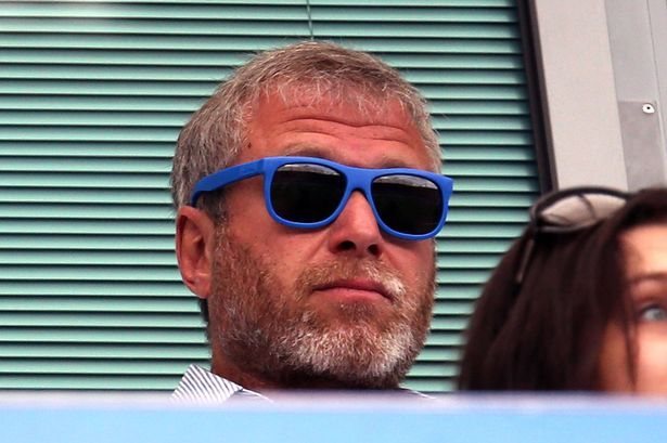 Roman Abramovich watches on with blue sun glasses on