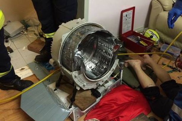 Man Trapped In A Washing Machine