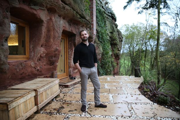 Angelo stands on the patio outside the completed Rockhouse
