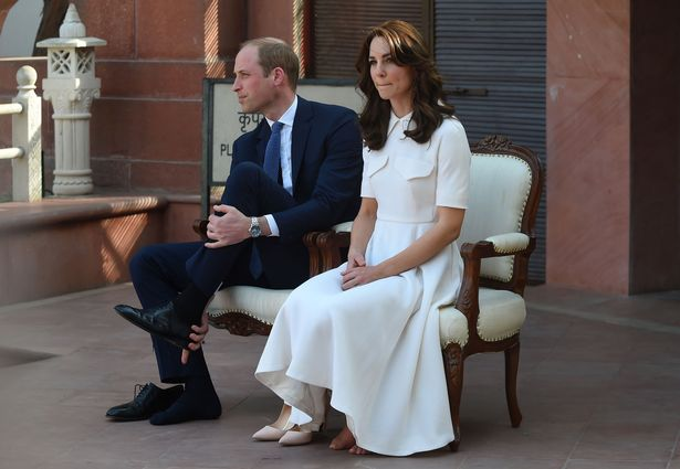 William and Kate remove their shoes at Gandhi Smiriti