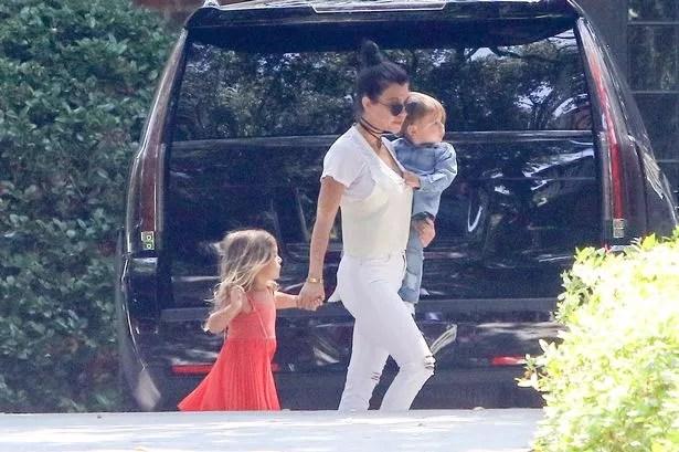 Kourtney and Kim Kardashian sport the same hairstyle