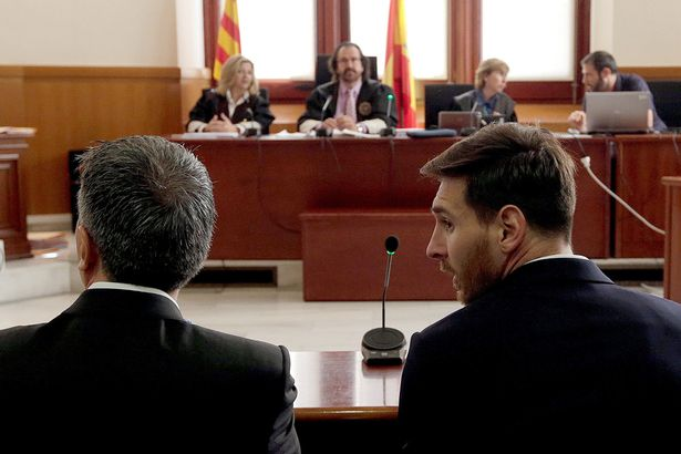 Lionel Messi (R) sits in court with his father Jorge Horacio Messi