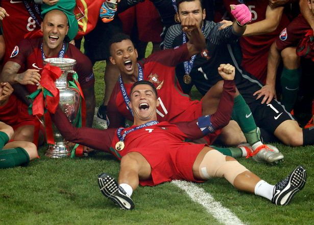 Portugal's Cristiano Ronaldo and team mates celebrate after winning the Euro 2016.