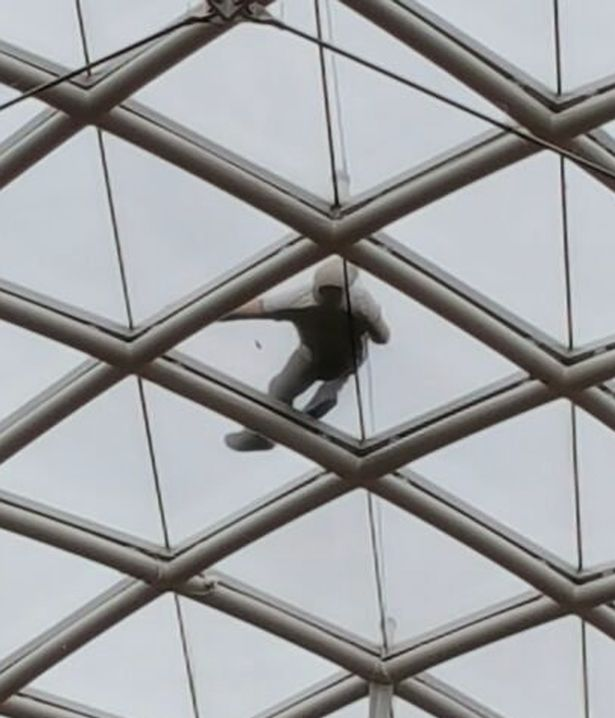 Labourer Isaac Moore passed out 75ft in the air on the glass roof of a shopping centre after downing six pints to celebrate landing a new job, a court heard