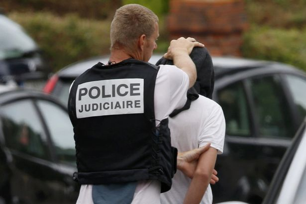 French judicial inverstigating police apprehends a man