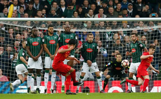 Liverpool's Emre Can takes a freekick