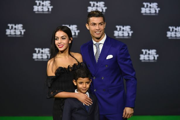 Real Madrid and Portugal's forward Cristiano Ronaldo poses with partner Georgina Rodriguez and his son Cristiano Ronaldo Jr as they arrive for The Best FIFA Football Awards 2016 ceremony, on January 9, 2017 in Zurich.