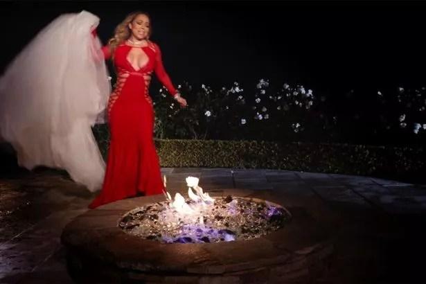 Mariah Carey sets her wedding dress ablaze in a new music video