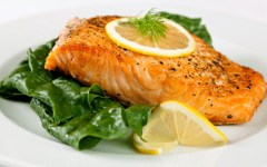 Salmon Served Over Baby Spinach
