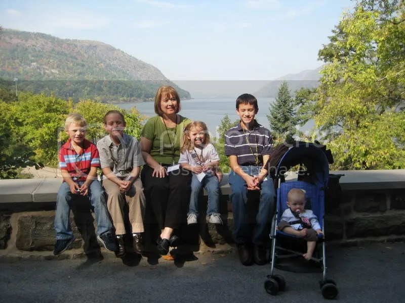 Grandma and the kids in front of the Hudson River