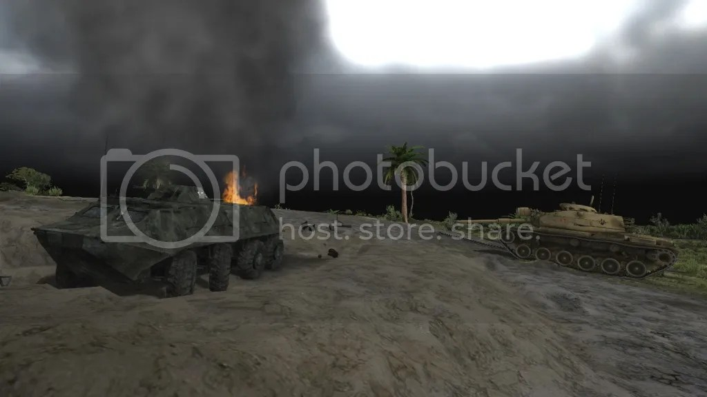 Smoldering scrap metal by a M60A1