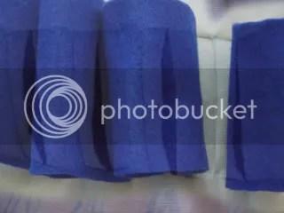 overlay of blue felt still ontop of sewn canvas slits