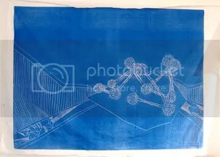 large blue woodcut on sheet, ramagon in space