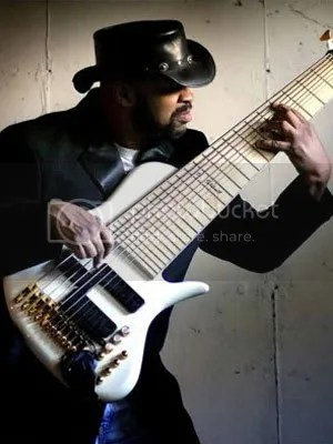 Whats more bad-ass, the 11-string bass or the hat? It might be the hat...