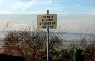 "sign which reads: ""Do Not Throw Stones at this Sign"