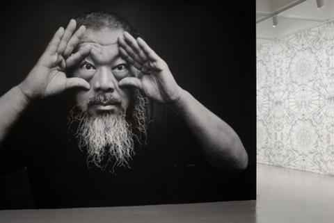 Ai-Weiwei-entrance-portrait-with-wall-paper-e150771.jpg