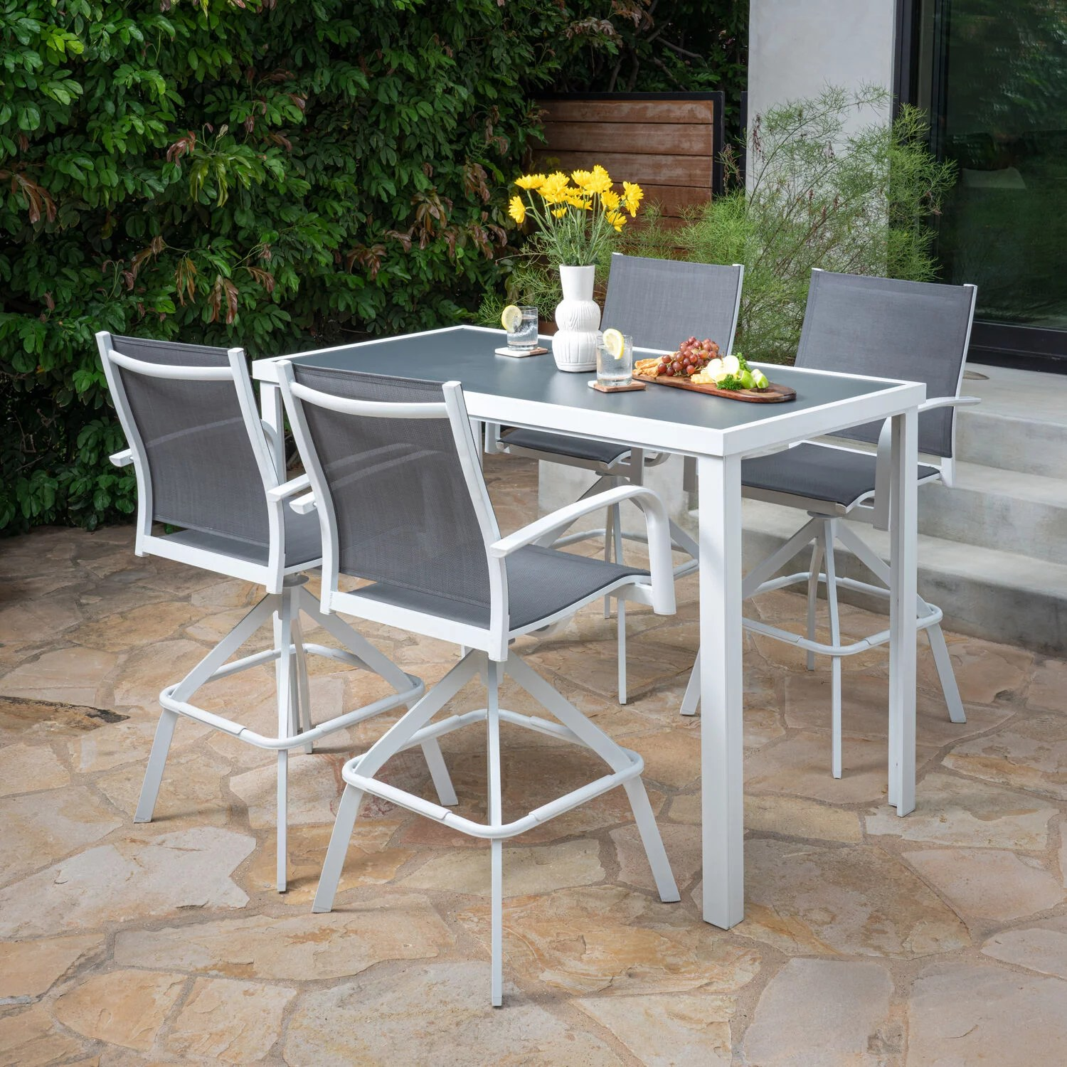 hanover naples 5 piece outdoor high dining set with 4 swivel bar chairs and a glass top bar table white