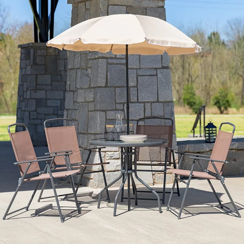 6 piece brown patio set with table tan umbrella and 4 folding chairs
