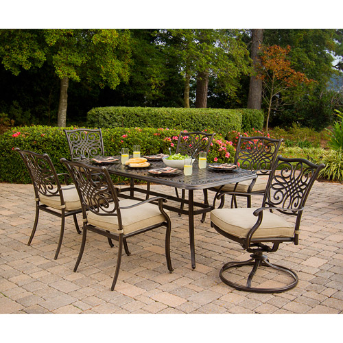 hanover traditions 7 piece outdoor dining set of four dining chairs two swivel chairs and a 38 x 72 in table