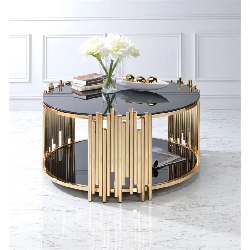 bowery hill round glass top coffee table in black and gold