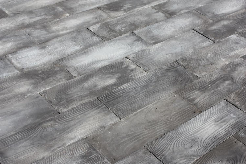 gray barnwood plank patio on a pallet paver kit