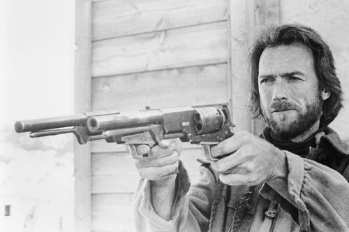 clint eastwood the outlaw josey wales pointing two guns pistols 24x36 poster