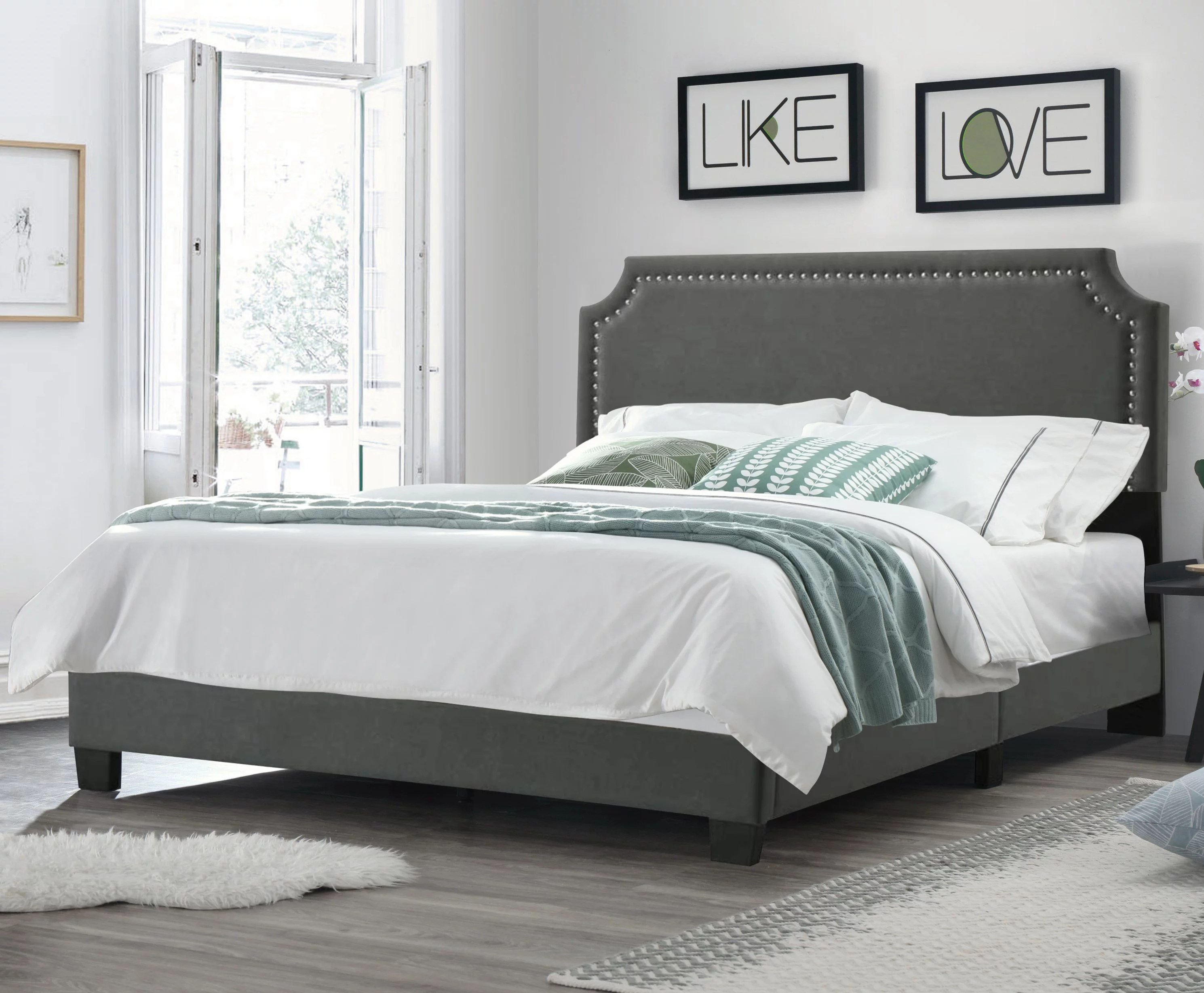 regal upholstered bed with nail trim headboard king