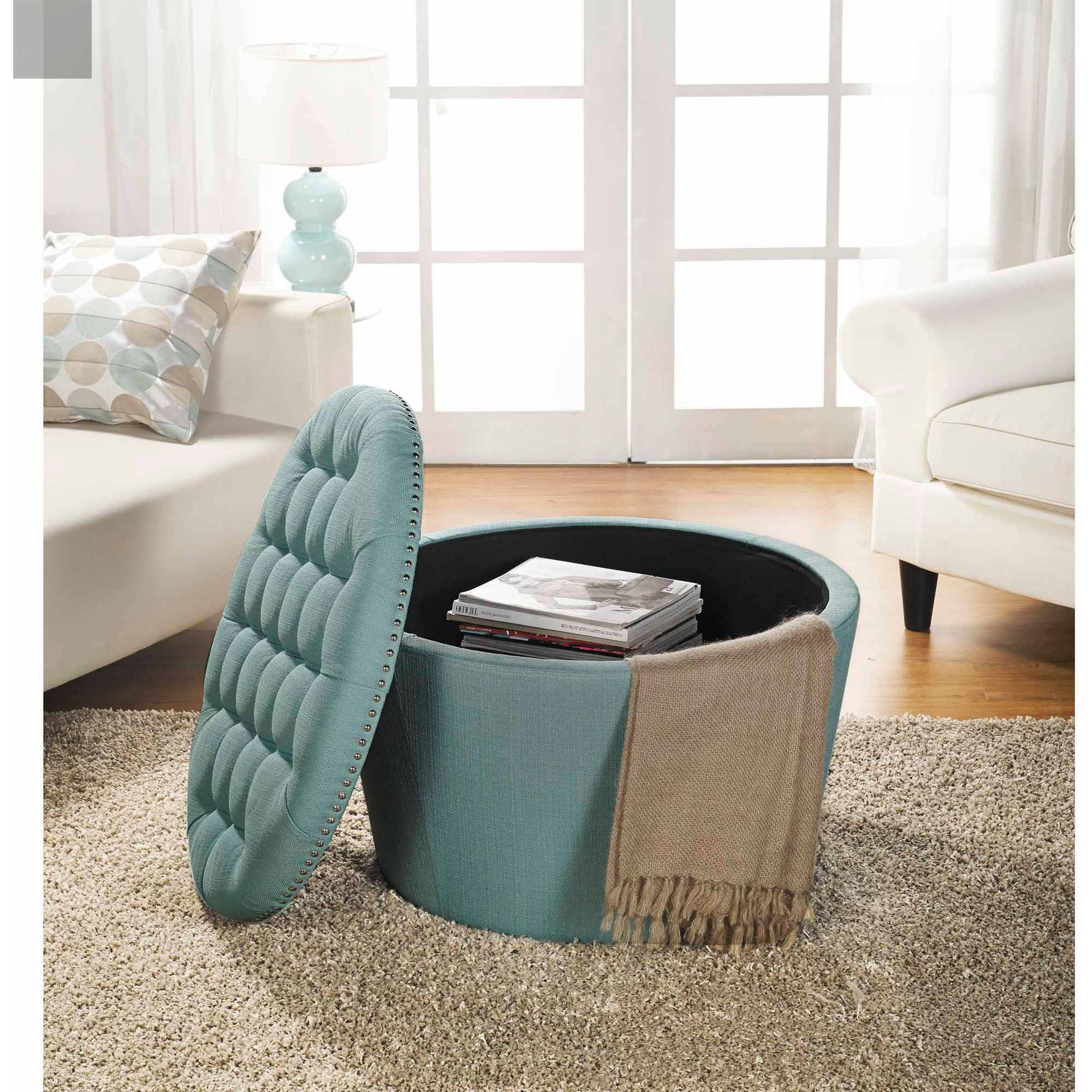 round upholstered coffee table with storage