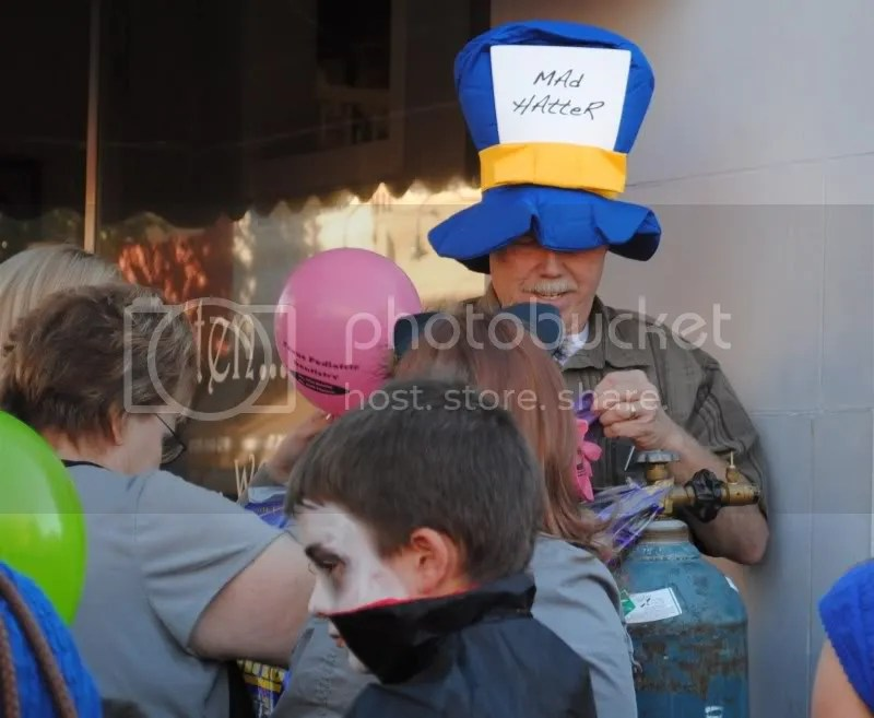 The Mad Hatter Blowing Up Balloons