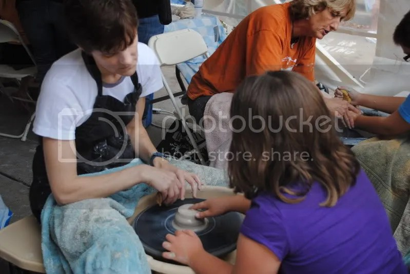 Kids Try the Pottery Wheel at the Art House Tent