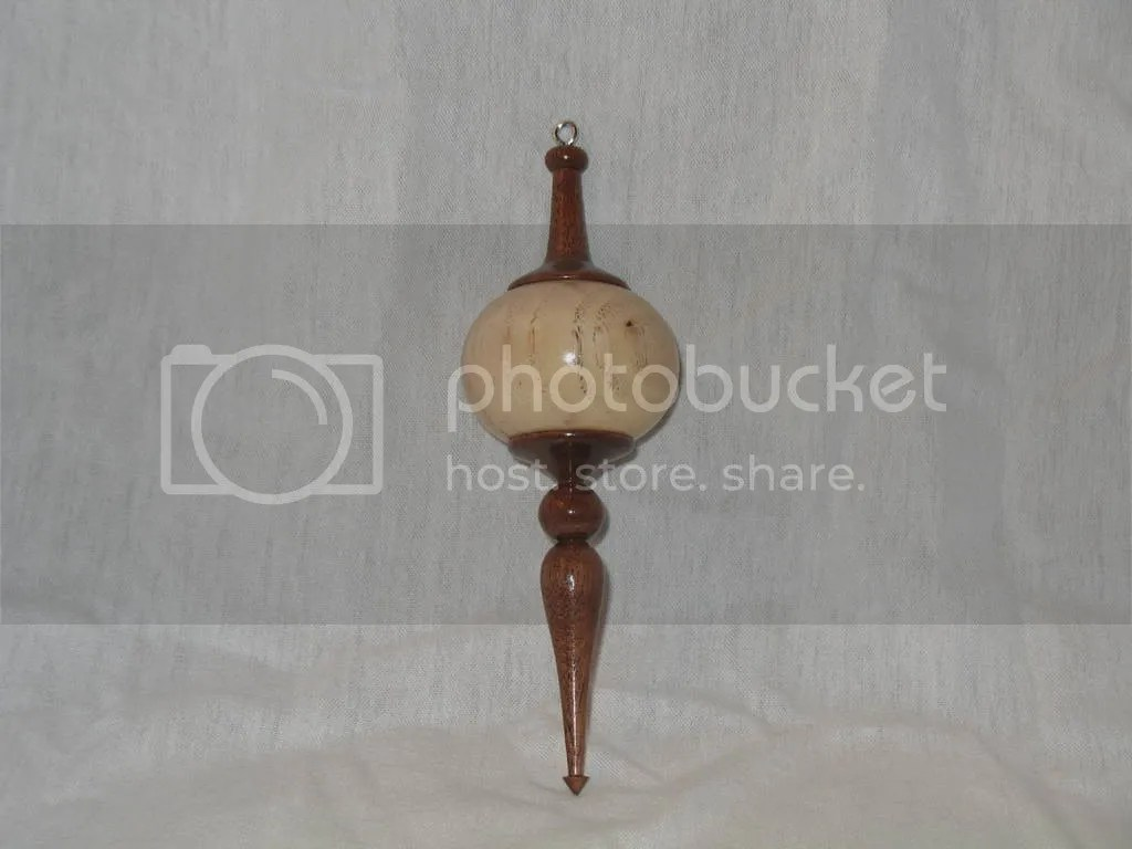 Peacan with walnut finials, $65
