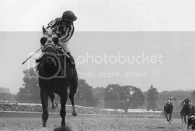 Ron Turcotte sneaks a peak at his lead in the Belmont Stakes.