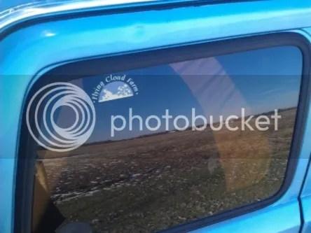 Flying Cloud Farm sticker on back window of truck