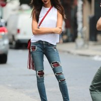 Sensational beauty!  Joan Smalls flaunts her model legs in cut out jeans