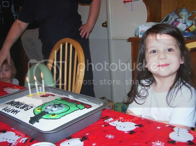 Posing with cake