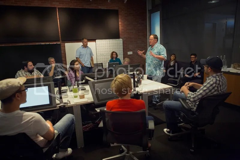 Director John Lasseter works with members of his story team on Disney•Pixar's