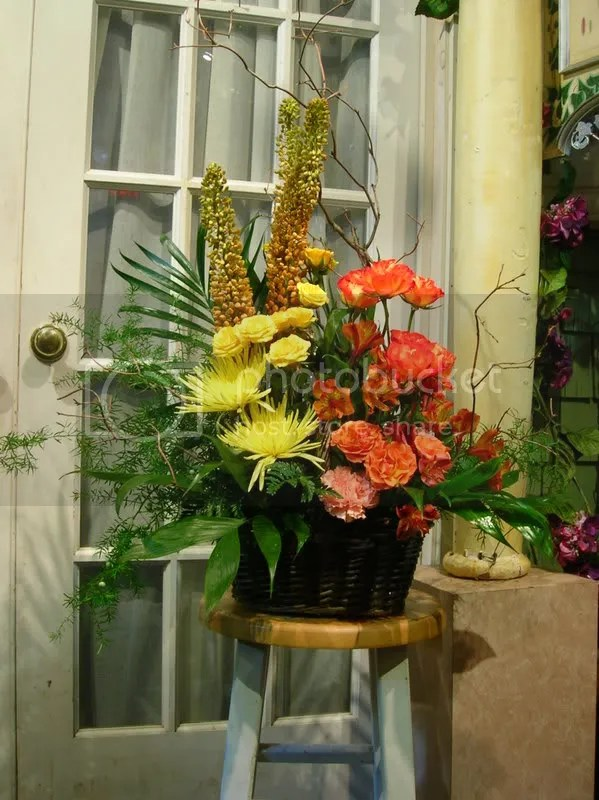 Here is the arrangement we created, using much more flora than the picture perscribed